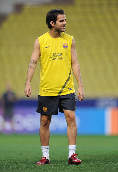 At the same Barcelona practice session, Cesc Fabregas wearing Nike soccer cleats.