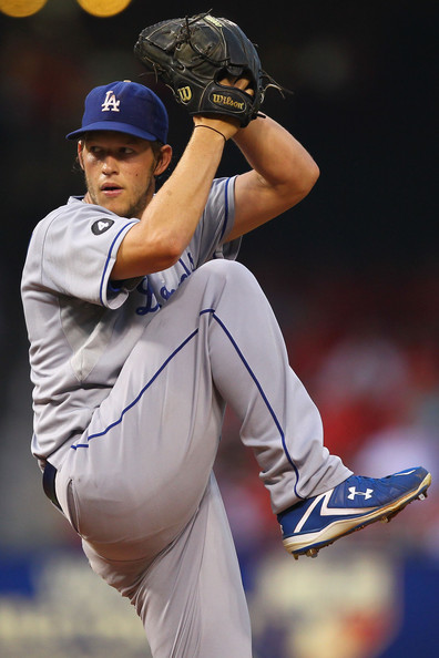 Clayton Kershaw wearing Under Armour cleats and a Wilson glove.