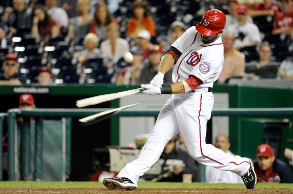 Even his New Balance cleats couldn't keep Danny Espinosa's bat from shattering during the earthquake.