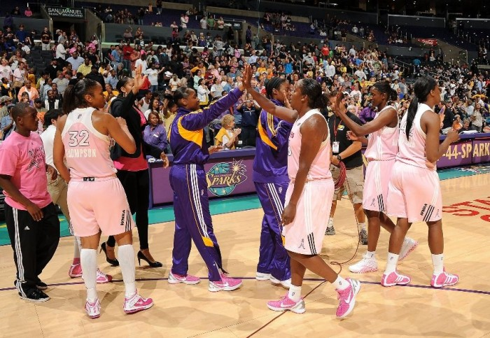 Los Angeles Sparks wearing pink basketball shoes