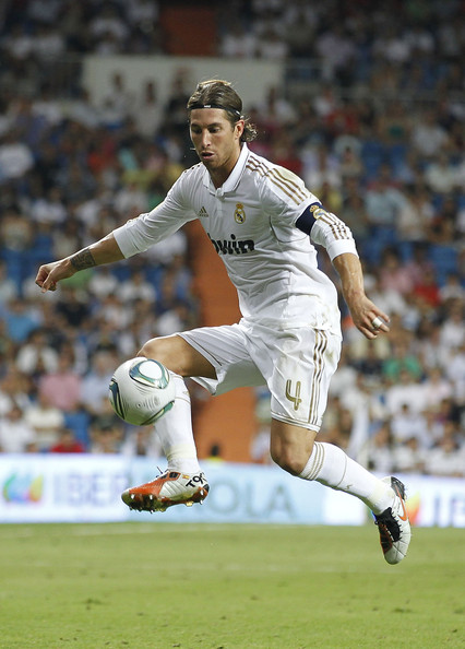 Sergio Ramos controls the ball with his Nike Total90 cleats.