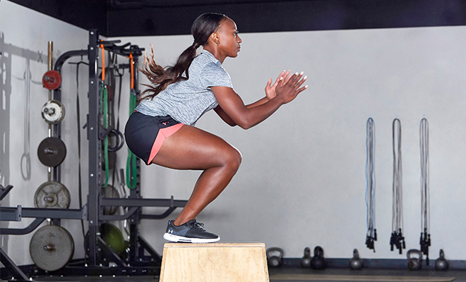 Athlete doing box jumps to increase her speed.