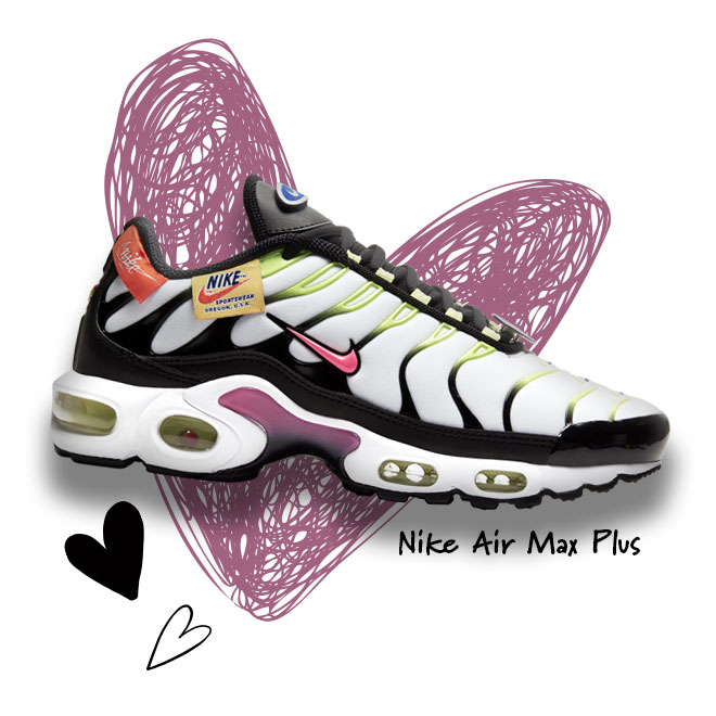 A Nike Air Max Plus sneaker in the White/Hyper Pink/Black colorway in front of a scribbled heart.