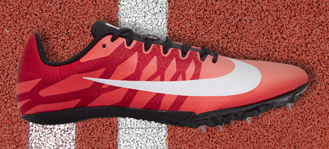 A Nike Zoom Rival S 9 track spike in the laser crimson/white/black/university red colorway lying on the track.