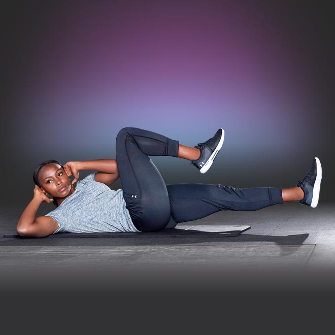 Jamia Fields does crunches on a yoga mat.